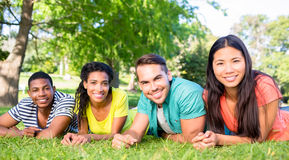 Friends lying at college campus Stock Image