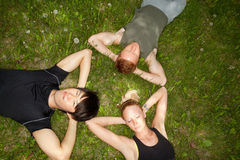 Friends lying down and resting Stock Images