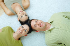 Friends lying on floor Royalty Free Stock Images