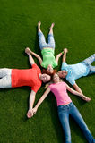 Friends lying on grass Royalty Free Stock Photography