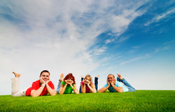 Friends lying on grass Stock Image
