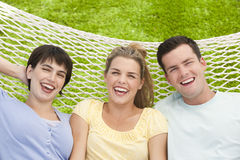Friends Lying In Hammock Stock Image