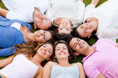 Friends lying outdoors Stock Photo