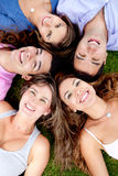 Friends lying outdoors Royalty Free Stock Images