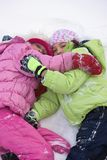 Friends Lying In The Snow Royalty Free Stock Photo