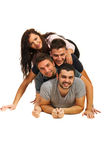 Friends lying on top of each other Stock Images