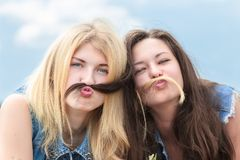 Friends make funny mustache from hair Stock Photos