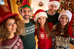 Friends makes fun on Christmas holyday. Cheerful friends makes fun on Christmas holyday Royalty Free Stock Photography