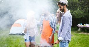 Friends making barbecue and having lunch Royalty Free Stock Image