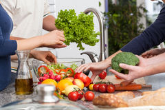 Friends making a salad Royalty Free Stock Photos