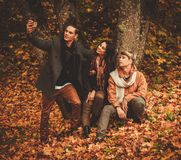 Friends making selfie in an autumn park Stock Images
