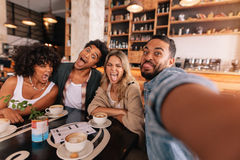 Friends making selfie with funny faces Stock Images