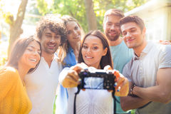 Friends making selfie photo on camera Stock Images