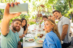 Friends making selfie photo in outdoor restaurant royalty free stock photos