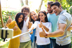 Friends making selfie photo outdoors Stock Photos