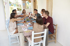 Friends making a toast at a dinner party on a patio, Ibiza Stock Image