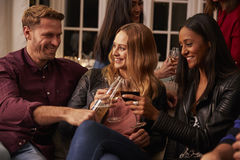 Friends Making A Toast With Drinks At House Party Royalty Free Stock Image