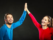 Friends man and woman celebrating giving high five Stock Photos