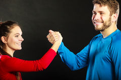 Friends man and woman clasping shaking hands. Royalty Free Stock Image