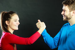 Friends man and woman clasping shaking hands. Royalty Free Stock Photography