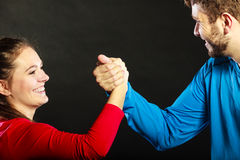 Friends man and woman clasping shaking hands. Stock Images