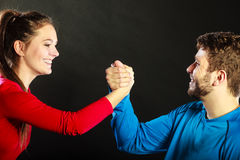 Friends man and woman clasping shaking hands. Royalty Free Stock Images