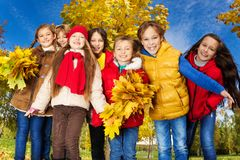 Friends in maple trees park Royalty Free Stock Images
