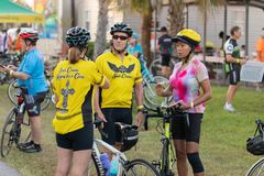 Friends meet to talk before the early morning ride. stock image