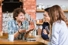 Friends meeting in cafe and drinking coffee Royalty Free Stock Image