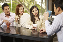 Friends meeting in cafe Royalty Free Stock Photos