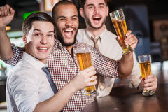 Friends meeting. Men shout and rejoice in meeting and drink beer royalty free stock image