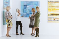 Friends meeting in museum stock photography