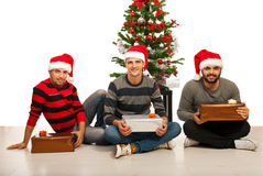 Friends men with Christmas gifts Royalty Free Stock Images