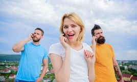 Friends and mobile. Beautiful young woman talking on the mobile stock photography