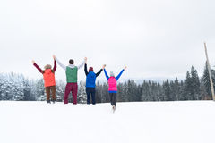 Friends On Mountain Top Winter Snow Forest, Young People Group Cheerful Raised Hands Stock Photos