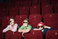 Friends in the movie theater Stock Image