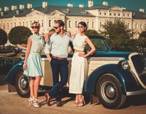 Friends near classic convertible Royalty Free Stock Images