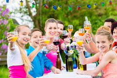 Friends and neighbors toasting on garden party Stock Images