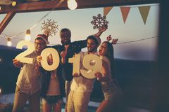 Friends at New Year`s Eve outdoor pool party stock images