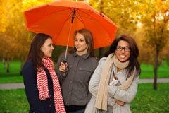 Friends not afraid of nasty weather Royalty Free Stock Photo
