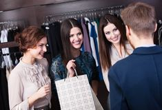 Friends occasional meeting in the shop Royalty Free Stock Images