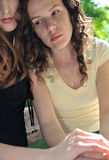 Friends - one teenage girl comforts another Royalty Free Stock Image