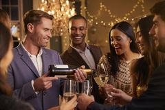 Friends Open Champagne As They Celebrate At Party Together Royalty Free Stock Photo