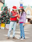 Friends Opening Christmas Present Royalty Free Stock Photo
