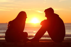 Free Friends Or Couple Of Teens Facing At Sunset Stock Photography - 76485092