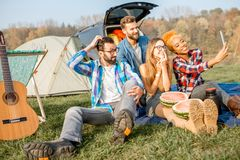 Friends during the outdoor recreation. Multi ethnic group of friends dressed casually having fun making a selfie photo together during the outdoor recreation Royalty Free Stock Photography