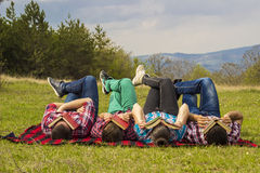 Friends outdoors with book Stock Photography