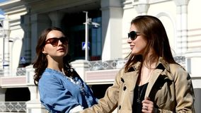 Friends outdoors on shopping mall background. On urban background stock video