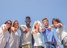 Friends outdoors with v hand sign Stock Images