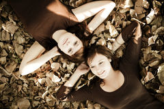 Friends over leaves. Young beautiful female friends over an autumn sheet Stock Image